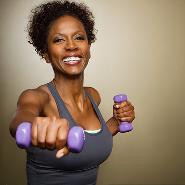 African American woman lifting weights..