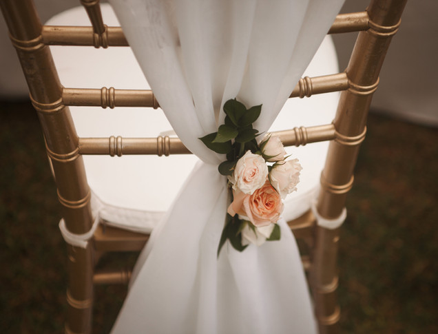 chair draping with floral accents