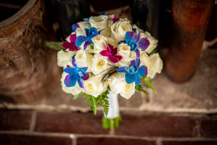 Rose and Orchid Bouquet with Peacock Feathers
