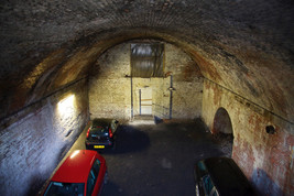 Car park under a railway viaduct, Norton Street, Salford