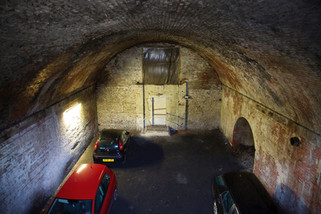 Car park beneath a railway viaduct on Norton Street, Salford