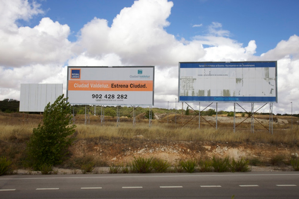 Faded advertising hoardings, Valdeluz