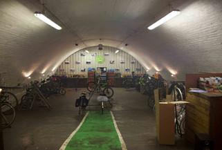 Bicycle repair shop in a railway arch, Dantzic Street, Angel Meadow