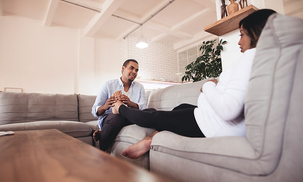 Canva - Husband Massaging His Pregnant W