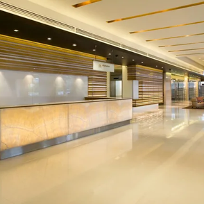 Modern office reception area with designer desk and seating area