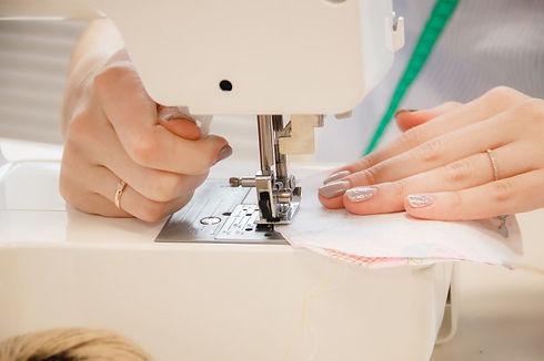 woman-seamstress-work-sewing-machine_956