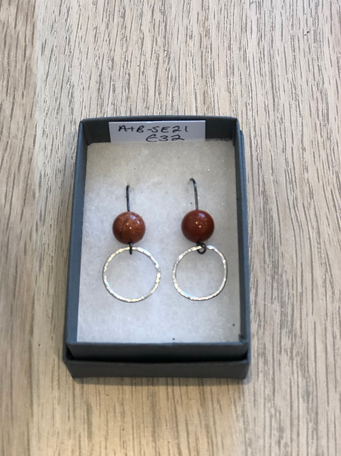 Ring and rust jasper bead