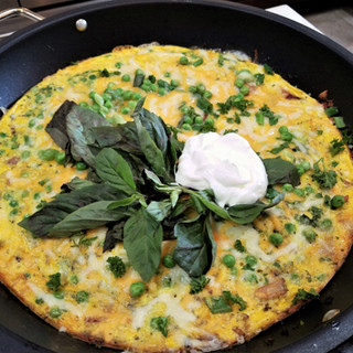 When the top is set Add the rest of the cheese and bake 3 more minutes. Remove the frittata from the oven and garnish before serving.