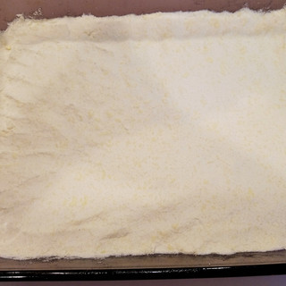 Spread evenly and press into pan firmly.