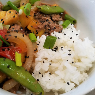 Serve over rice with scallions and sesame seeds