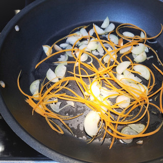 Heat the skillet then add a teaspoon of pecan or canola oil and saute the shallots and julienne carrot for 3 minutes.