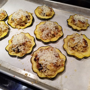 Fill the baked squash rings with the stuffing and top with more shredded mozzarella.
