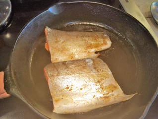 heat the cast iron pan until very hot then sear the salmon starting skin side up