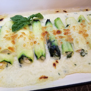 When the cannelloni are hot and bubbly and the cheese is just beginning to brown in spots, remove them from the broiler.