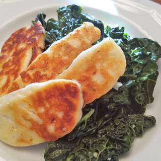 Serve the Tuscan Kale topped with a few slices of the fried Halloumi.