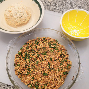 Place the nuts and parsley for the topping in a pie plate then roll the cheese ball around in it until it's well covered, pressing lightly.