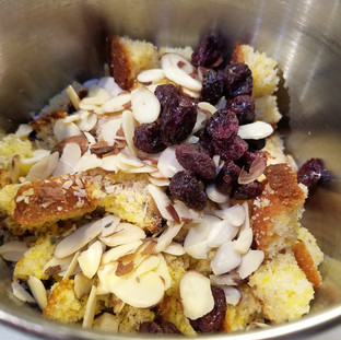Mix the almonds and cranberries into the torn corn bread.