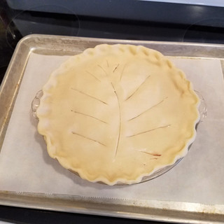 Prepare a baking sheet with foil or parchment paper to place on the rack beneath the pie to catch drips if the pie leaks.