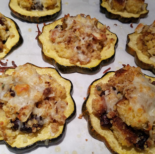 Return the stuffed acorn squash to the oven until the stuffing is warmed, toasted and the cheese on top is golden and bubbly.