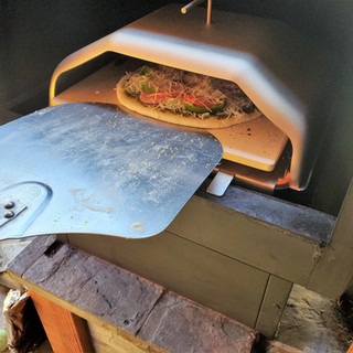 Turn your pizza half way around during the bake.