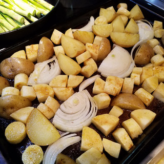 Potatoes, parsnips and onions ready to roast.