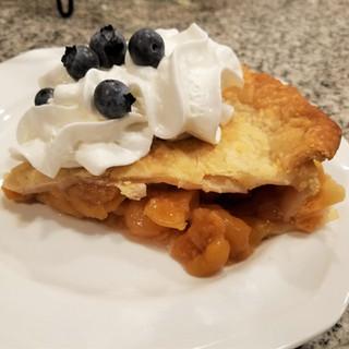 Rainier Cherry Pie Slice with Whipped Cream and Fresh Blueberries