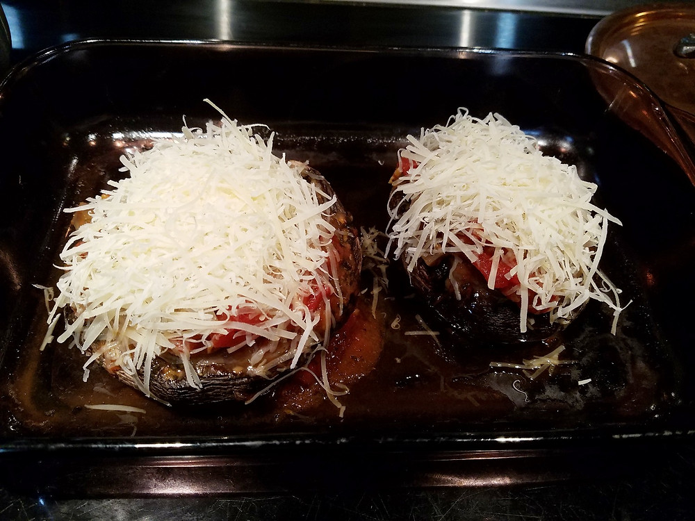 Topping the stuffed portabello mushrooms