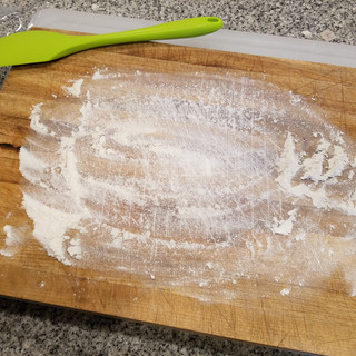 Using the floured board again, scrape the dough out and very gently knead 4 or 5 times again then form it back into a ball.