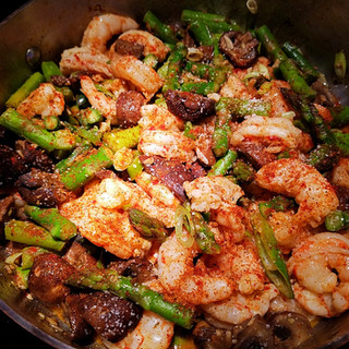 Stir-fry about 3 minutes or until the shrimp are nearly done then turn off the heat under the skillet and add the last 2 tablespoons of butter, the chopped scallion and diced Serrano pepper.