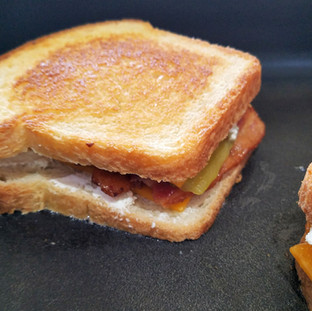 Lower the heat if you need to and continue to grill the sandwiches until the cheese is melted and the bottom is grilled to a golden brown.