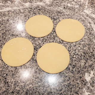 Remove the excess dough and save it to roll out for the next batch.