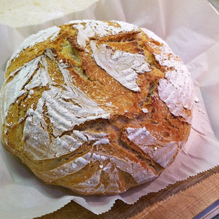 Remove the bread from the Dutch oven to cool completely before slicing.