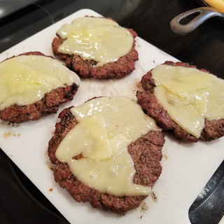 Remove the burgers when the edges are crispy and caramelized and the cheese is just melted. About 8-10 minutes total.