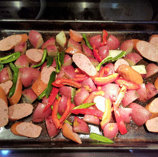 Roasting the sheet pan sausage and veggies.