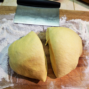 Now cut the dough into 2 equal parts.