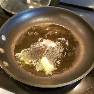 Start heating the pan over medium high heat. After it's hot, add some oil and butter.
