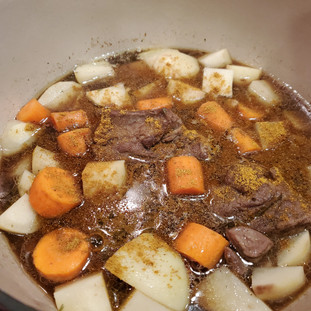 Now add the chopped potatoes and carrots then stir in the curry powder if you are using it.