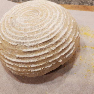 Roll the formed loaf out onto the prepared parchment paper.