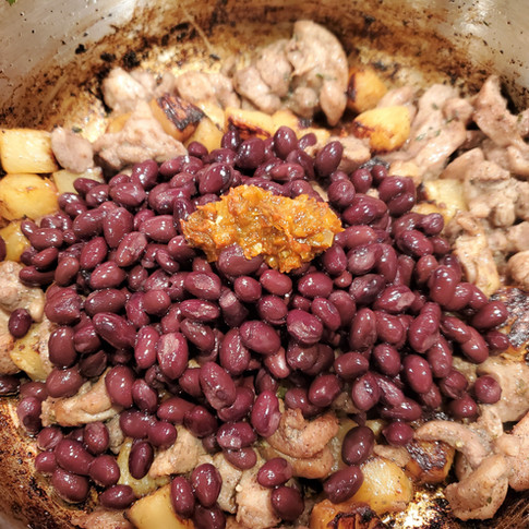 Stir in the black beans and habanero pepper.
