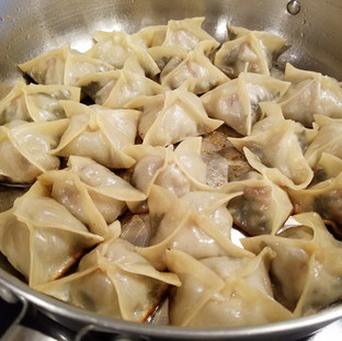 Fry the pot stickers until the bottoms are crispy and brown, then add 1/2 cup water, cover and reduce the heat to simmer for 10 minutes.