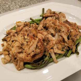 To plate the dish, place the Charred Green Beans on a platter first, then lay the pork chops over them, finally pourthe sauteed chanterells and butter sauce over the top.