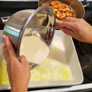 Pour the batter into the baking dish with the butter.