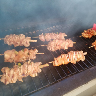 Place the skewers on the grill and start basting.