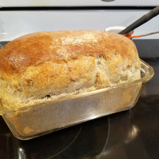 Bake the loaf for 35-40 minutes then brush the top with melted butter.