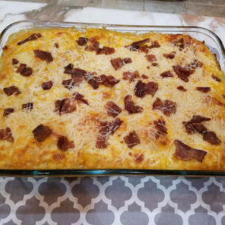 Finish with a thin layer of pumpkin sauce covering all of the top noodles,the Parmesan cheese and a final scatter of bacon.
