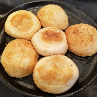 Meanwhile, add the buns cut side down to a cast iron pan that you have pre-heated to medium.
