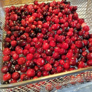 Use a slotted spoon to move the syrup soaked berries to a basket or screened drying rack.