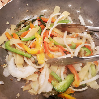 Stir-fry until the onions and peppers are barely tender.