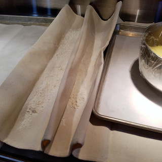 Prepare the proofing cloth while the dough rises.