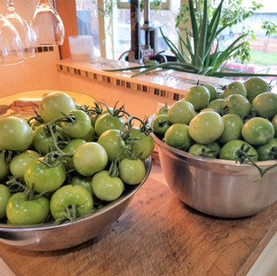Wash and remove stems from the green tomatoes.
